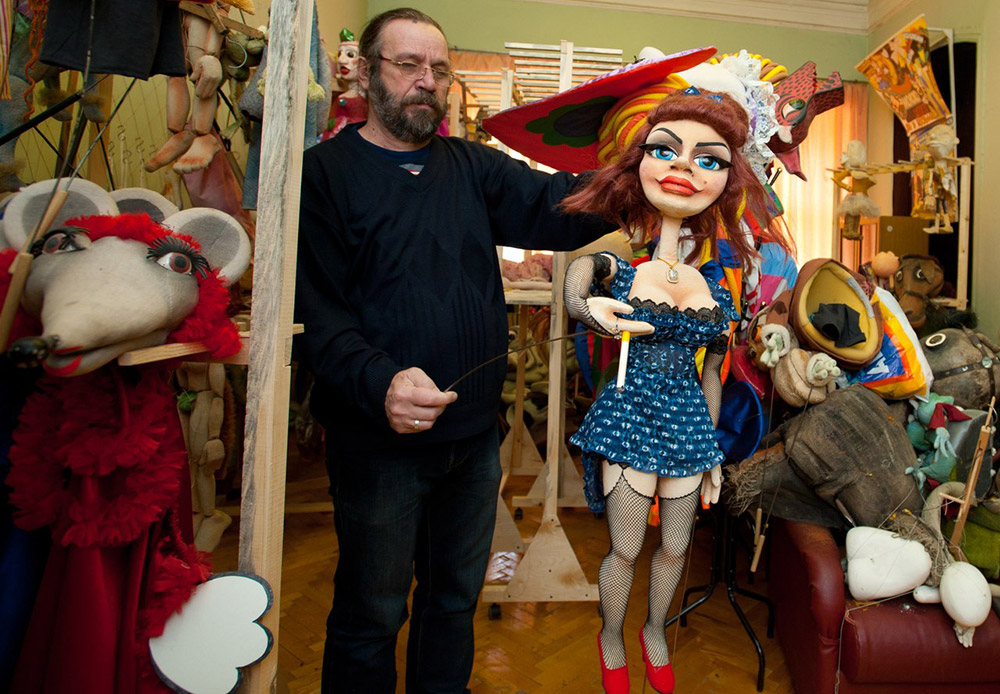 """After a show is removed from the repertoire, the used puppets go to the theater's storage. Heroes from all past shows """"live"""" here, like time-worn knitted bunnies or puppets of girl that no longer appear on stage..."""