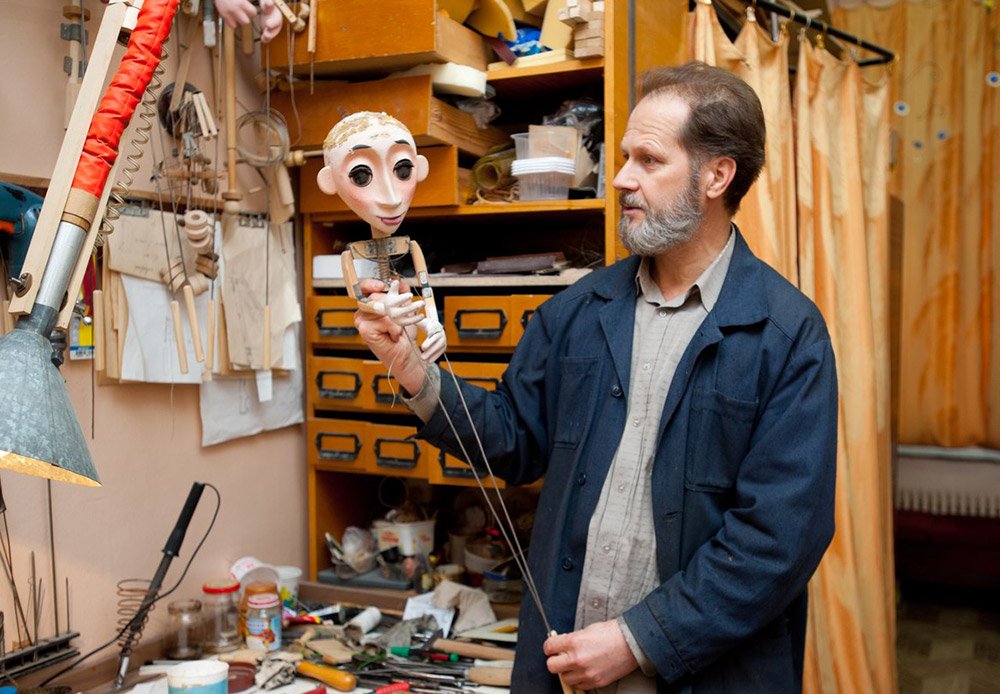 Alexander Tikhonov, the theater's engineer, prepares a special device: a wooden rod that the puppet is held from.