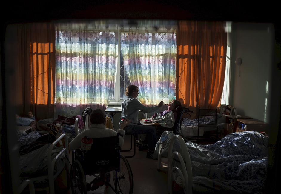 """""""They understand that they're living in a boarding house, not their own home. Some of them understand that they're different. Maybe it's easier for the ones who don't comprehend this,"""" the caregiver opines."""