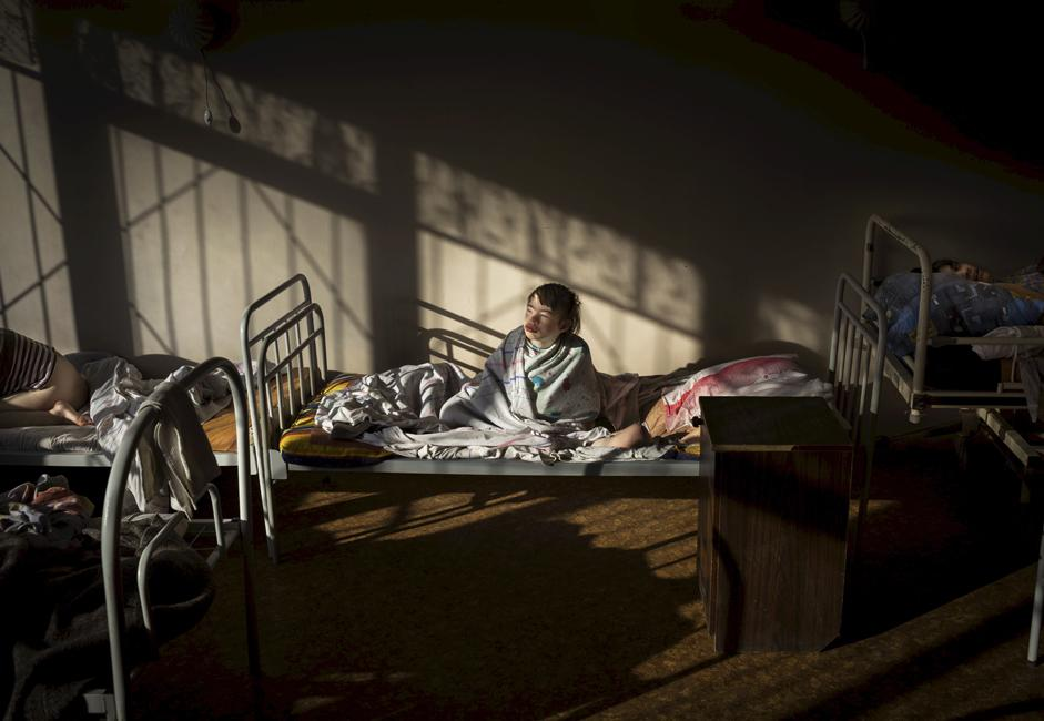 Provided with basic necessities, some of the residents stay in their beds all day long.