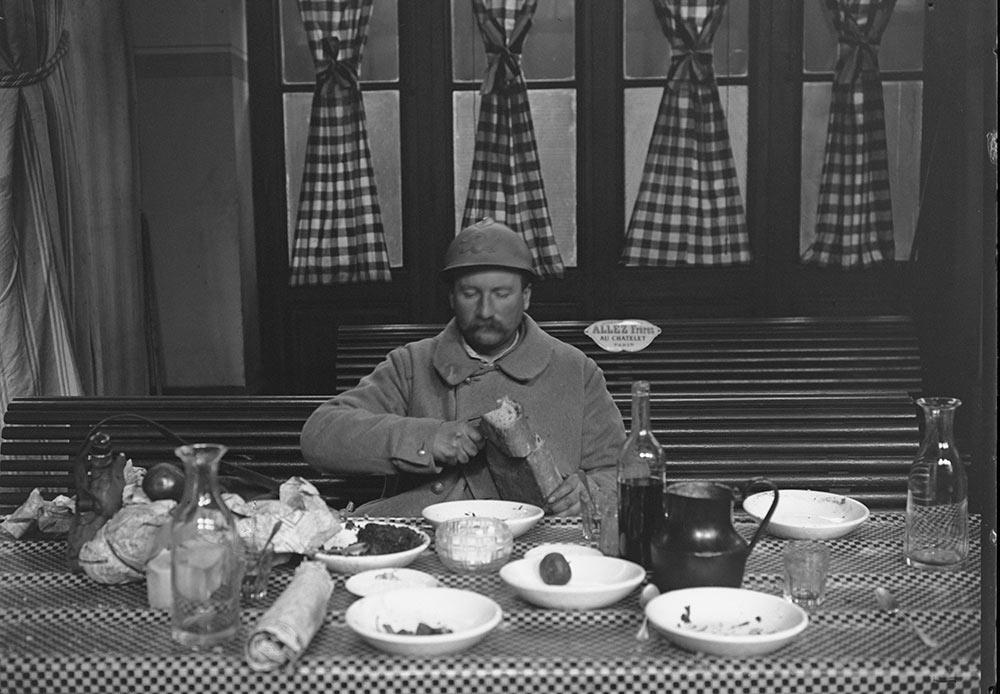Jacques Moreau, A serviceman on leave dines in the Gare de l'Est military canteen. Paris, January 1917