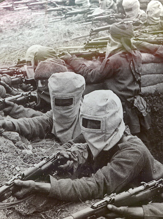 "Infantry equipped with high-pressure gas masks, having taken the ""Hun"" trench, fire on the retreating enemy"
