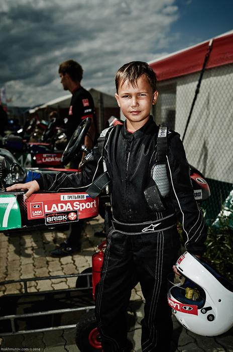 Zhenya, from Tolyatti, is 9. His equipment includes shoes, a racing suit, a helmet and gloves. All of that gets destroyed in accidents and crashes.