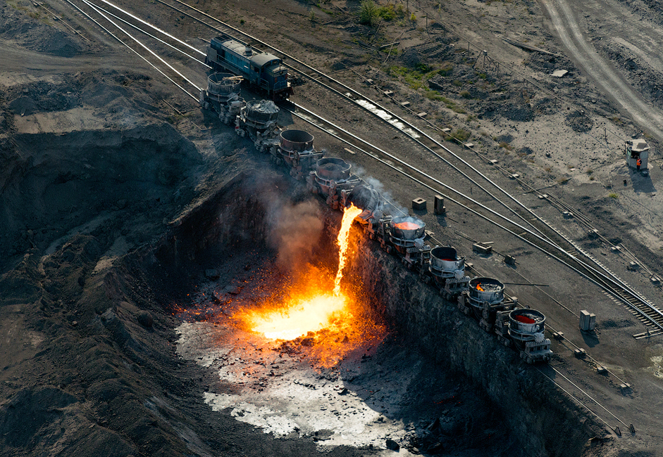 Pouring slag. Slag is a by-product or waste material resulting from the production of metal. After the remains of valuable metal components have been washed out, it is sent to the dump.