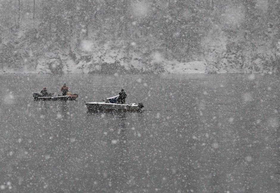 """Fishing."" Taken during first snowfall on the Yenisei river near Krasnoyarsk."