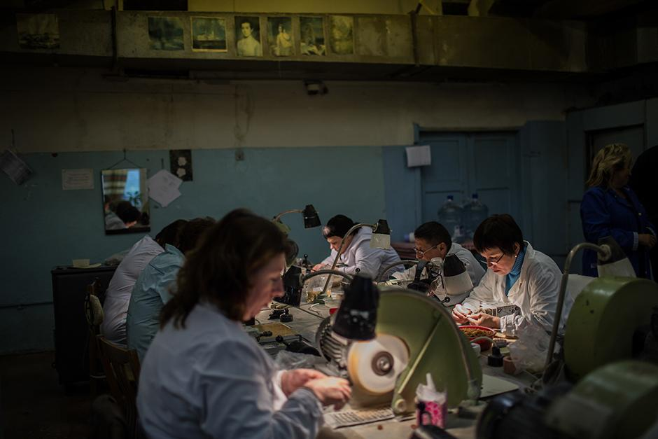 Staffers of the Amber Combine's processing factory grind pieces of amber. The factory still uses outdated, Soviet-era equipment, and its product can barely compete with more sophisticated amber articles from Poland, Lithuania and China.
