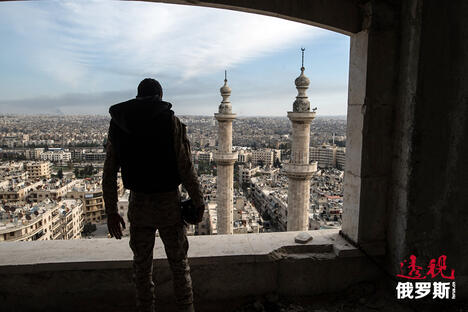 A soldier of the Syrian Arab Army is seen here in Aleppo CN