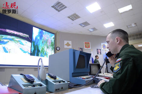 officer inside the command center CN