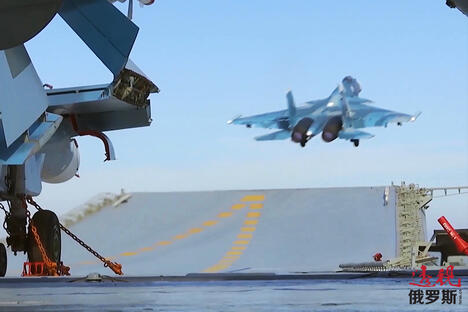 Su-33 fighter takes off from the deck of Admiral Kuznetsov aircraft carrier CN