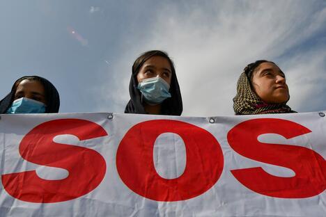 Afghans migrants take part in a rally outside the U.S. Embassy in Bishkek, Kyrgyzstan