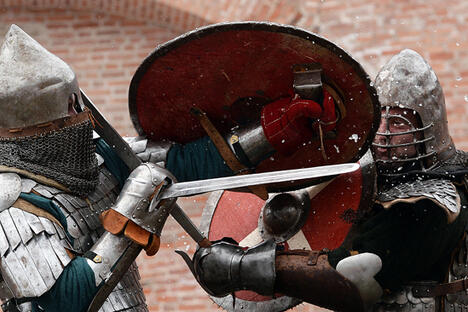 Participants in the Muster of Martial Retinues reenact a fight between warriors at the walls of the Novgorod Kremlin. Source:  Konstantin Chalabov / RIA Novosti