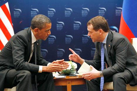 梅德韦杰夫与奥巴马在首尔的会晤。摄影: AP