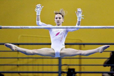 图中:俄罗斯国家体操队队员维多利亚·科莫娃。摄影:Corbis / FotoSA