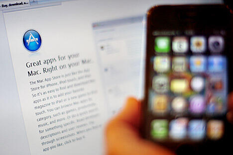 一名俄罗斯程序员找到了一种方法,绕过苹果公司网上应用商店的安全系统,使得用户无需购买就能获得在线游戏的额外产品。图片来源:Getty Images / Fotobank