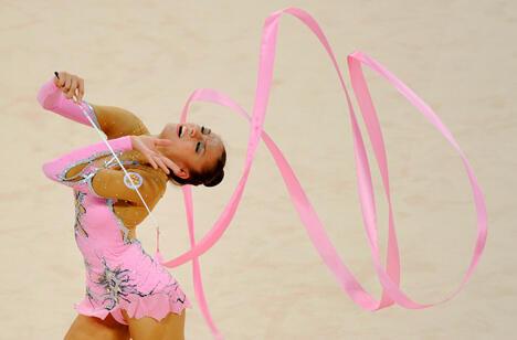 叶夫根尼娅·卡纳耶娃是俄罗斯艺术体操的奥运冠军,图片来源:塔斯社