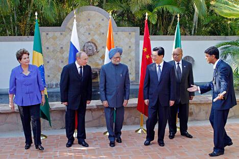 金砖国家中每个成员国都有其强大的一面。中国为经济,巴西为资 源和生态环境的潜力,印度为人口和科学,南非为非洲的门户。作者将政治和 军事实力视为俄罗斯强大的一面。图片来源:AP