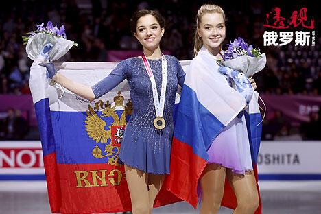 Gold medal winner Evgenia Medvedeva of Russia and bronze medal winner Elena Radionova of Russia CN