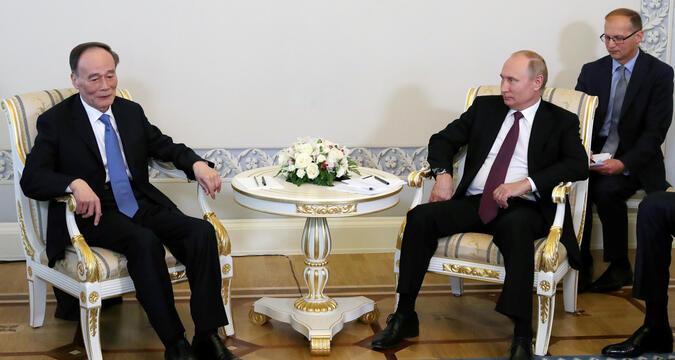 Putin and Wang Qishan