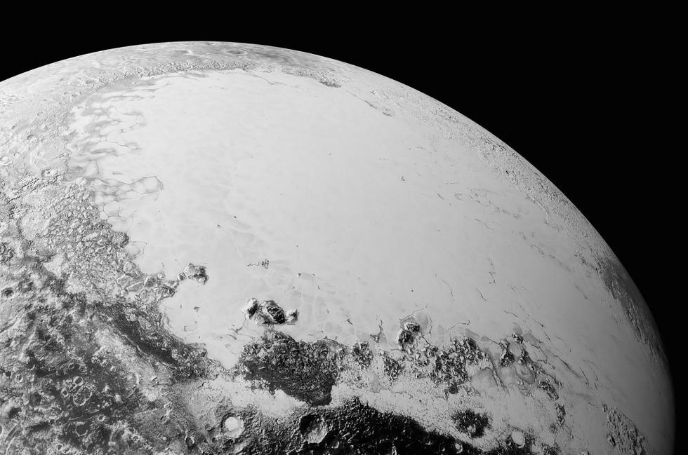 """冥王星上的""""斯普特尼克""""高原。图片来源:NASA / Wikipedia"""