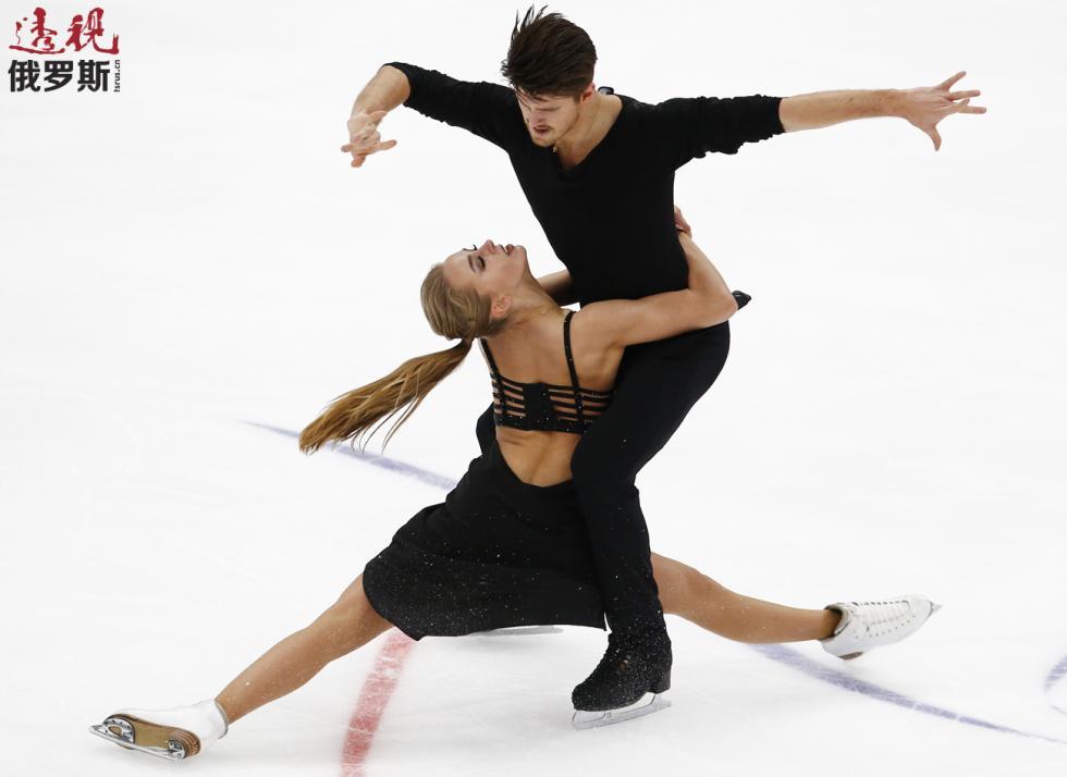 亚历山德拉·斯捷潘诺娃与伊万·布京。图片来源:AP