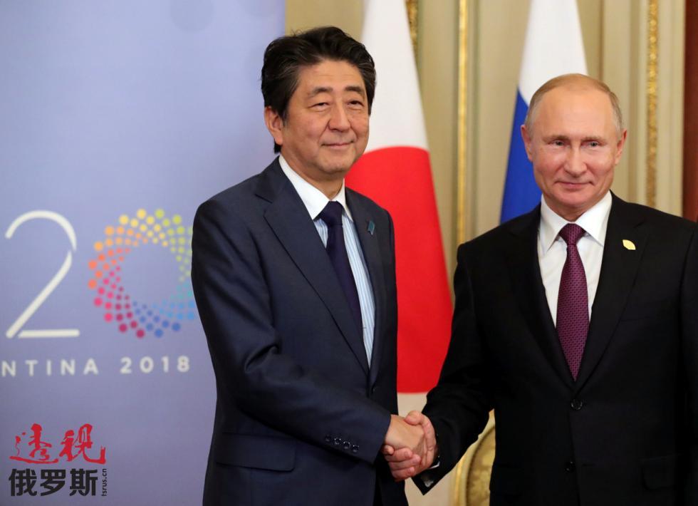 2018年12月1日。俄罗斯总统普京与日本首相安倍晋三。图片来源:路透社